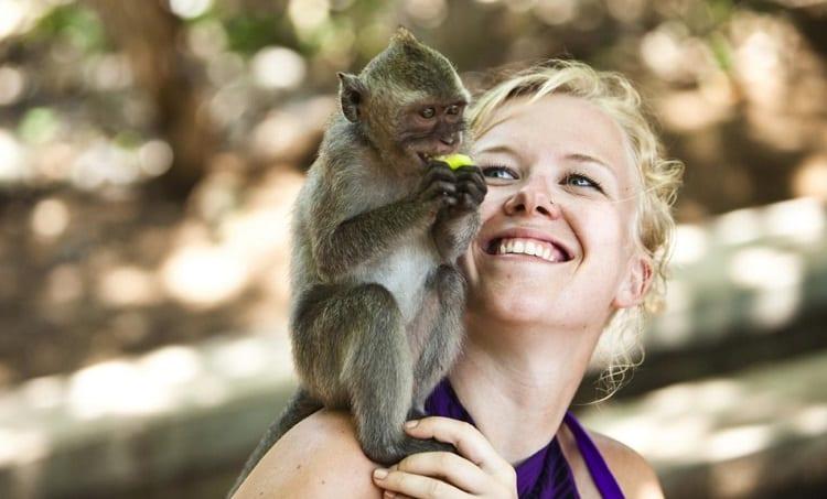 Woman Holding Monkey